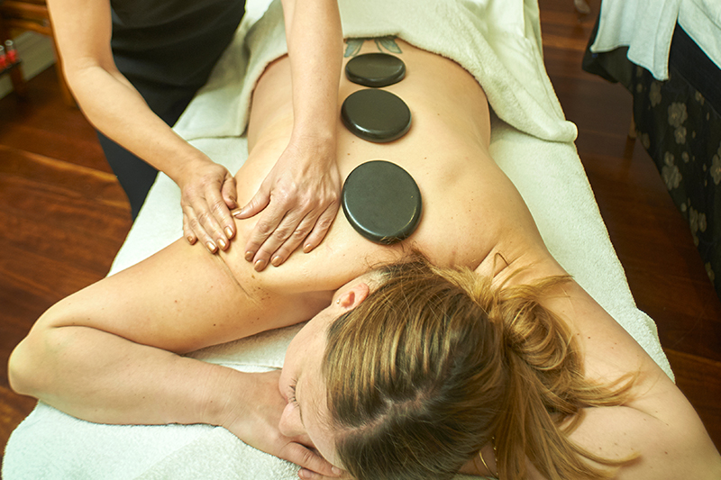 hot stone massage at the wellness retreat Woodman Estate